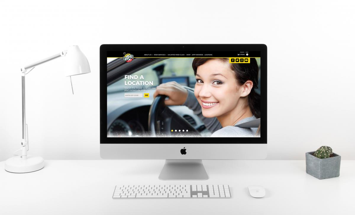 Zips Car Wash website mocked up on computer sitting on white desk