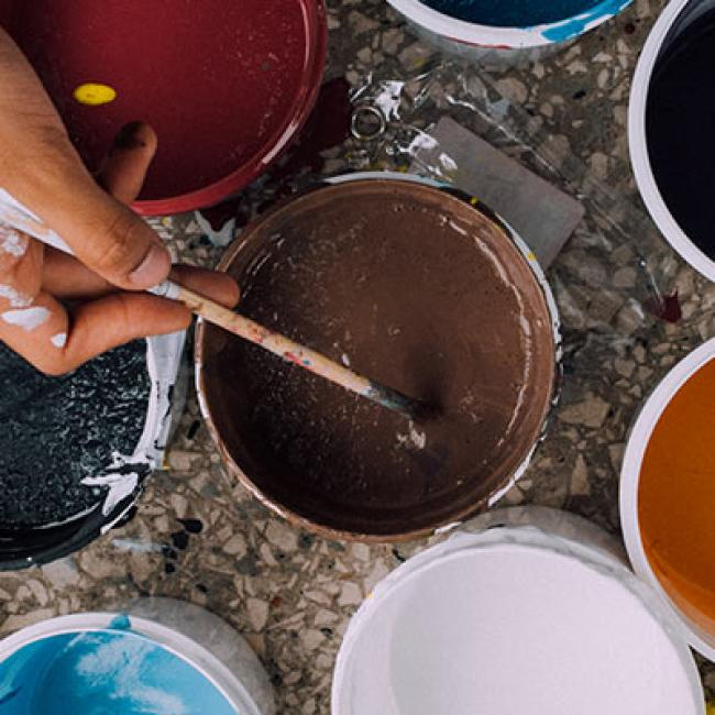 many colors of paint in buckets