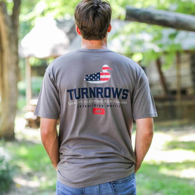 a man modeling a Turnrows graphic T-shirt
